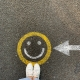 smiley face on the ground